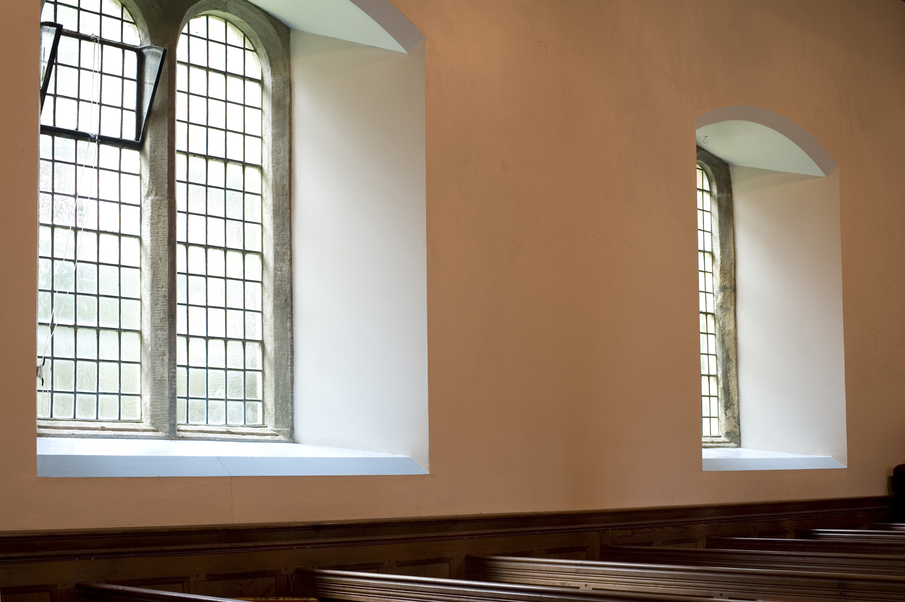 church_windows.jpg - Bright and airy church windows allowing the sunlight to stream in over the wooden pews