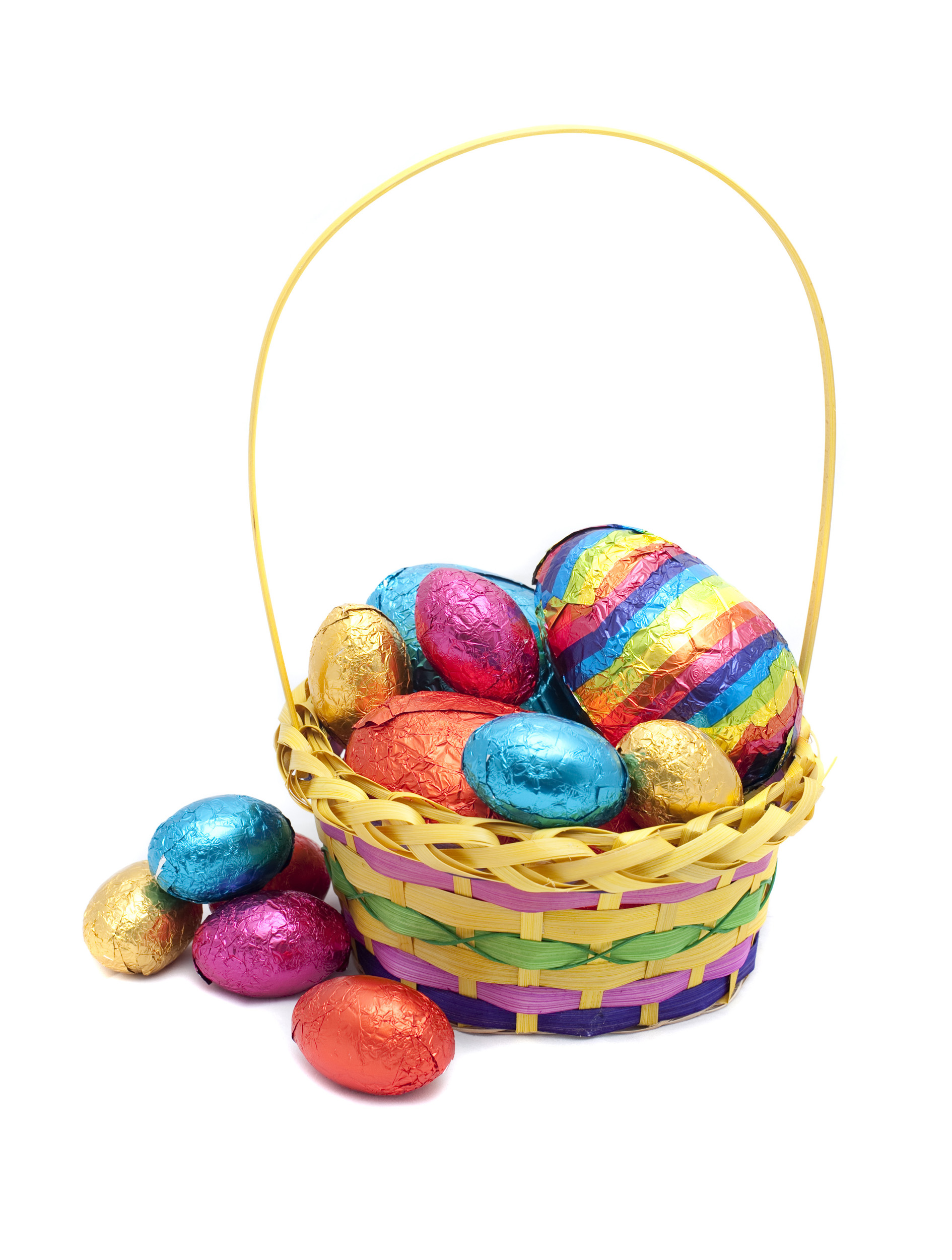 basket_of_eggs.jpg - Pretty decorative basket of colourful foil wrapped chocolate Easter Eggs on a white studio background