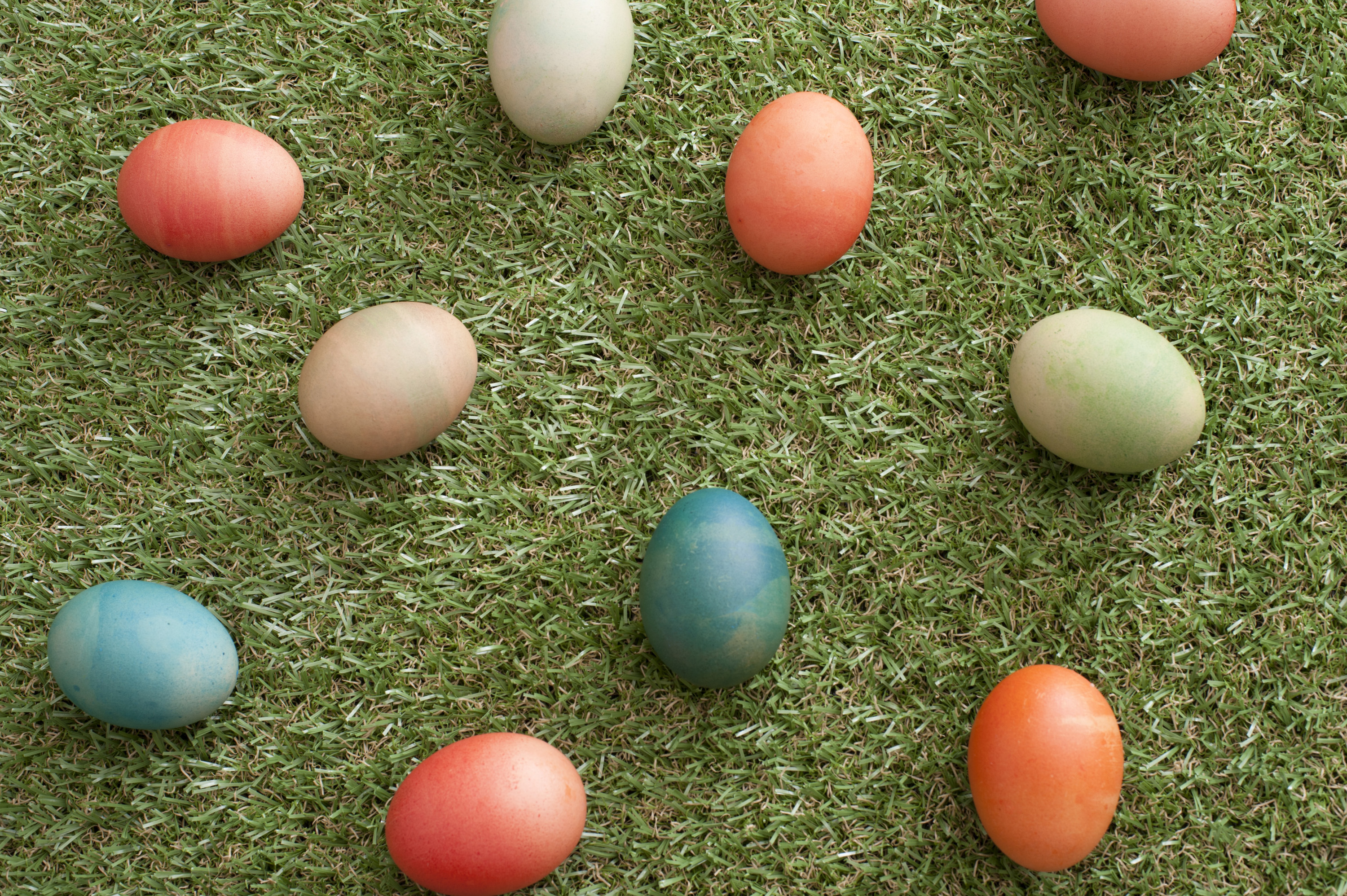 easter_eggs_background.jpg - Ten colorful Easter eggs placed gently on grass as seen from an overhead view