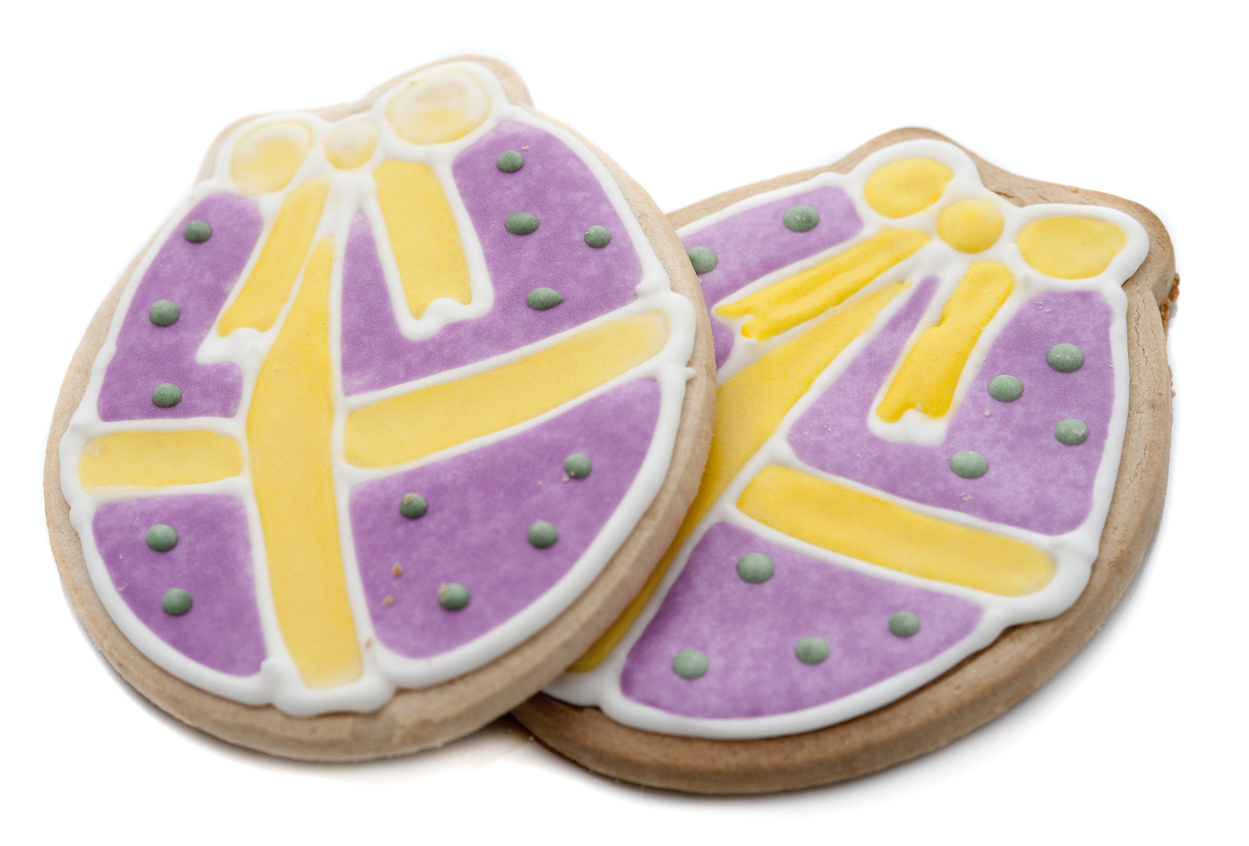 easter_egg_biscuits.jpg - Decorative biscuits in the shape of an Easter Egg glazed with colourful icing depicting wrapping and a large golden bow