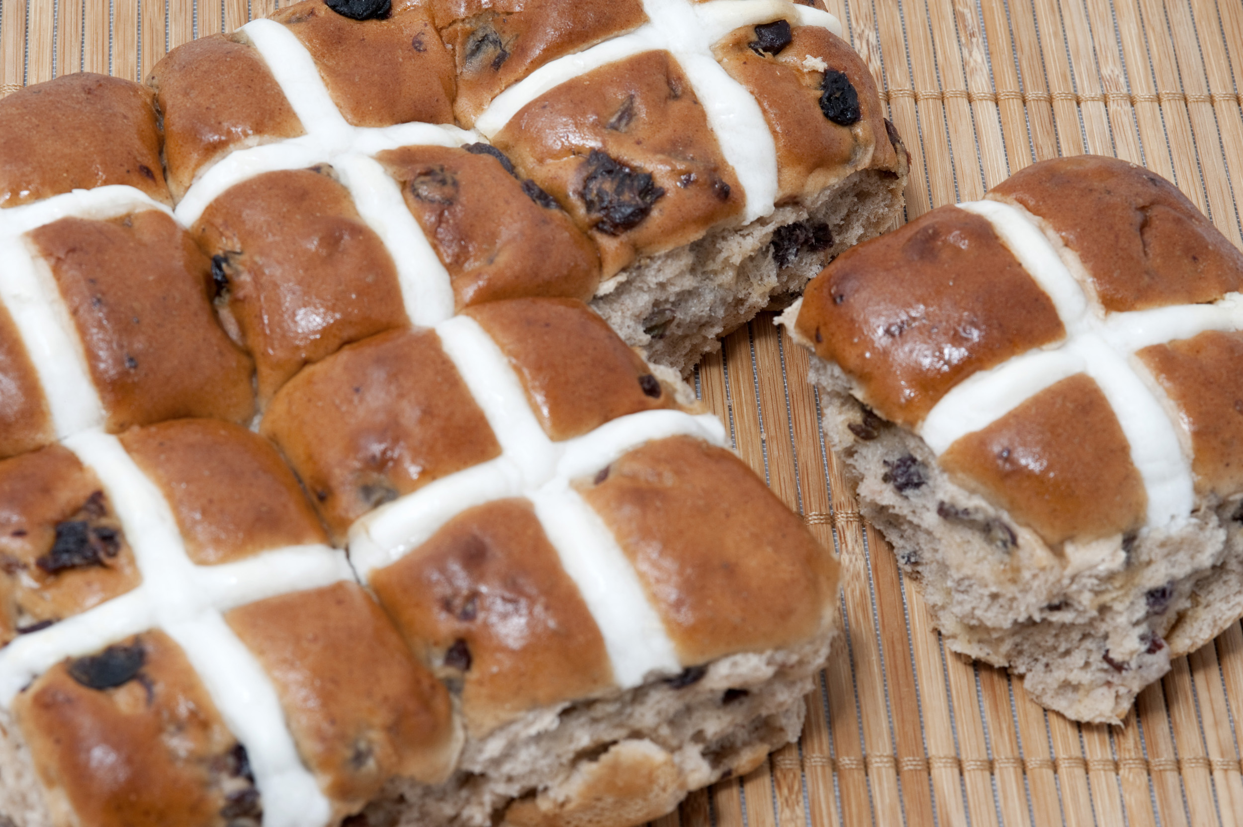 fresh_hotcross_buns.jpg - A freshly baked batch of Hot Cross Buns from an overhead perspective showing the glazed symbolic Easter cross
