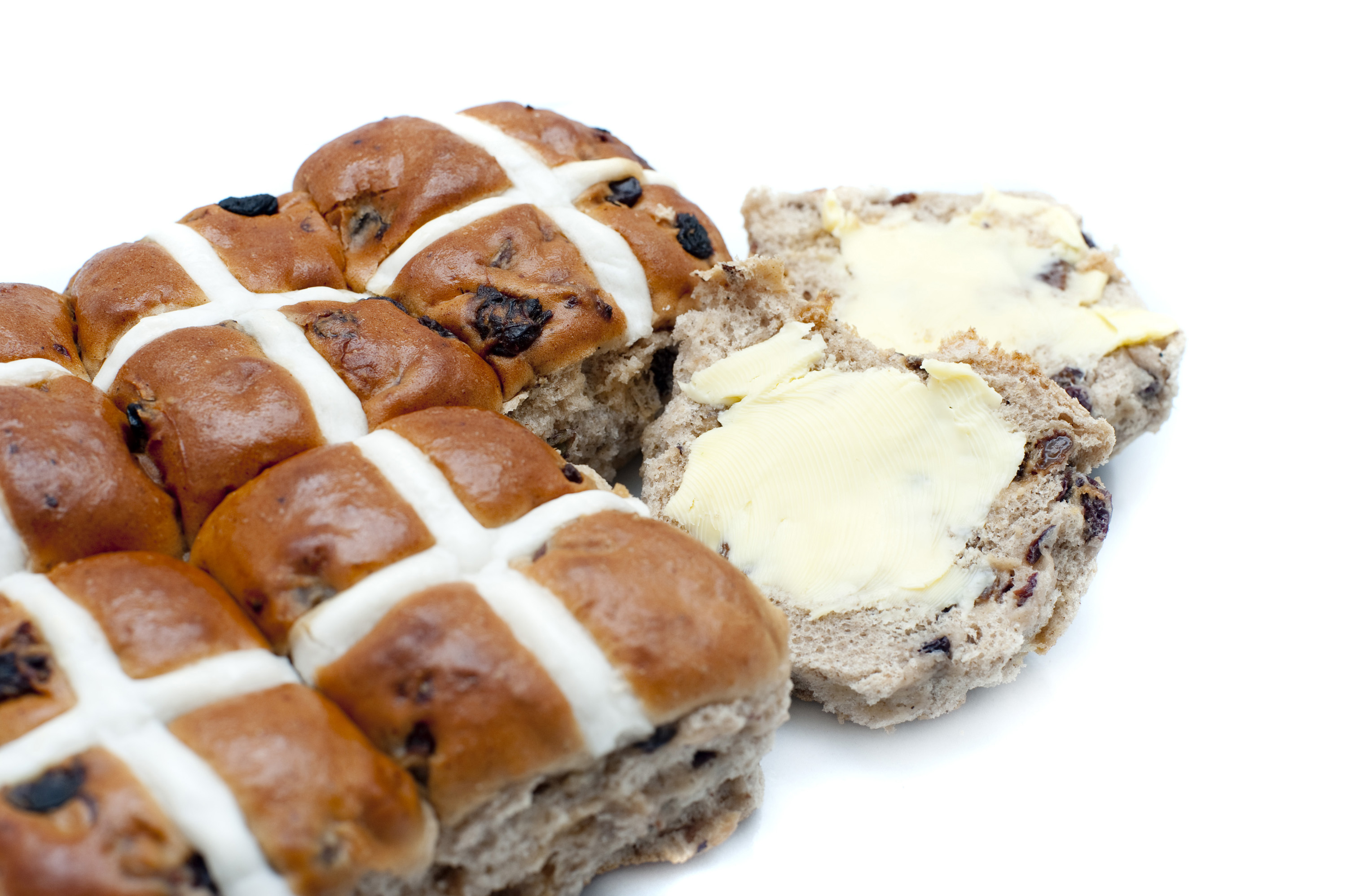 good_friday_bun.jpg - Batch of spicy Easter Hot Cross Buns with one sliced and buttered ready to eat