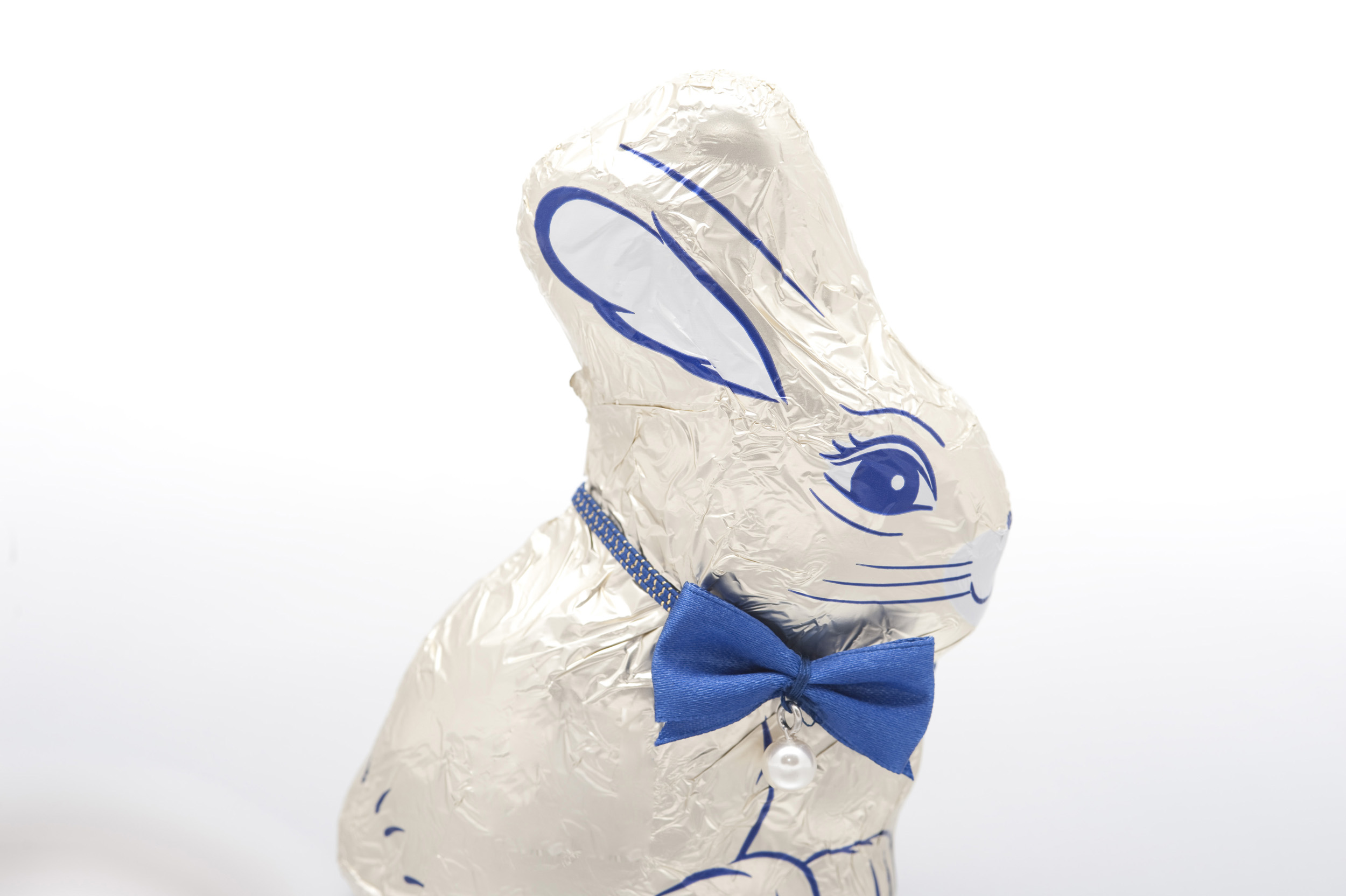 chocolate_easter_rabbit.jpg - Chocolate Easter Rabbit still in its decorative foil wrapping with a blue bowtie